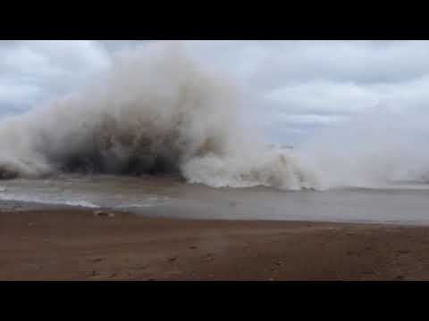 High Winds, waves and Storm Damage Along The Lake Michigan Shoreline.